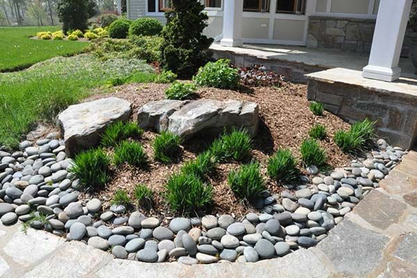 Decorative River Rock And Boulders Anchor A Curve In The 400 x 300