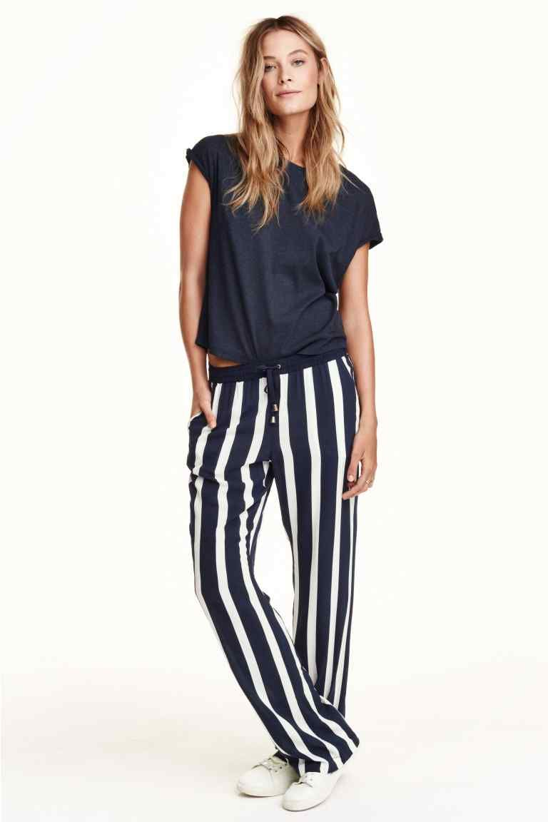 489aed75bd50 Easy take on the loose striped pants look. Tie at the elastic waist. Shown  with loose navy cap sleeved tee shirt. White sneakers. Just hangin' around.