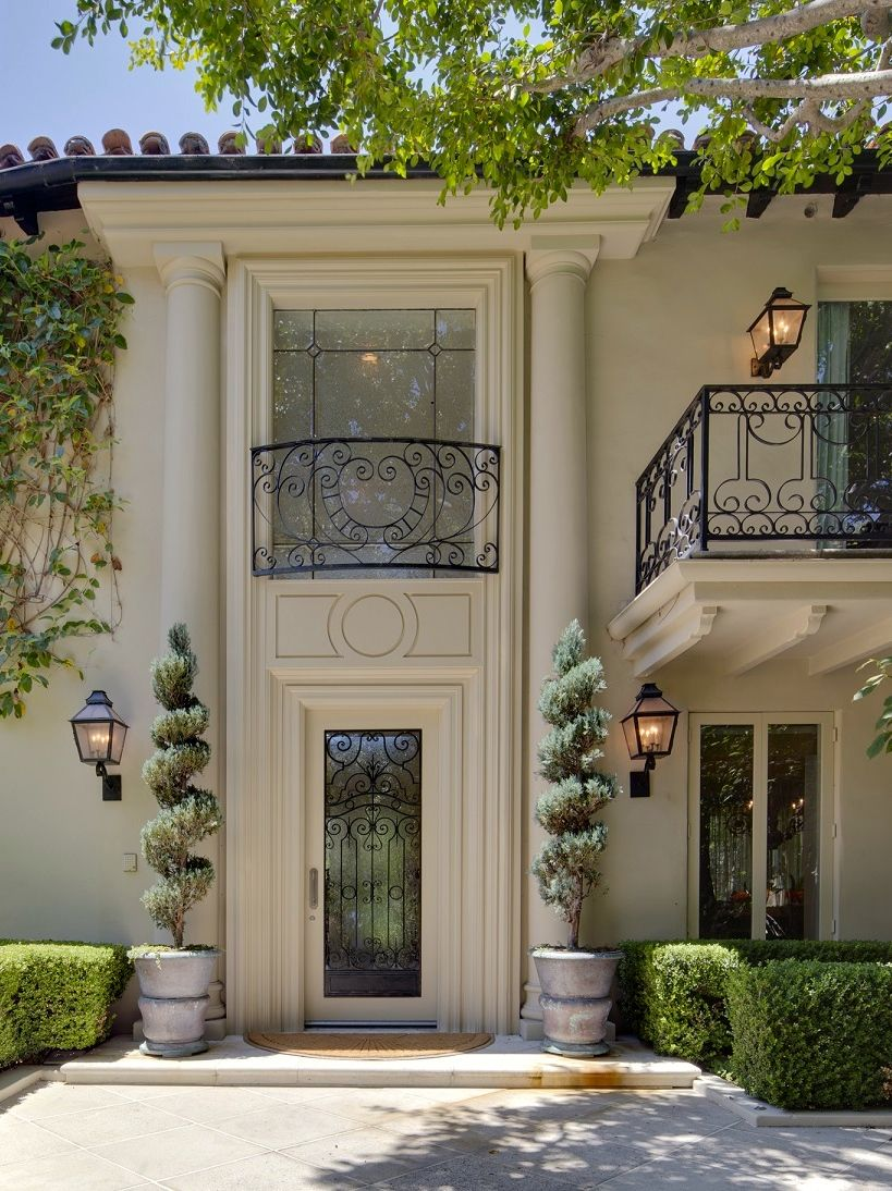 Wrought iron in a mediterranean style ome for Mediterranean style entry doors