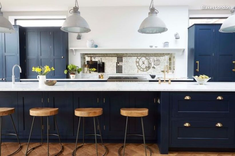 Indigo cabinets set against carrara marble   Blue kitchen ...
