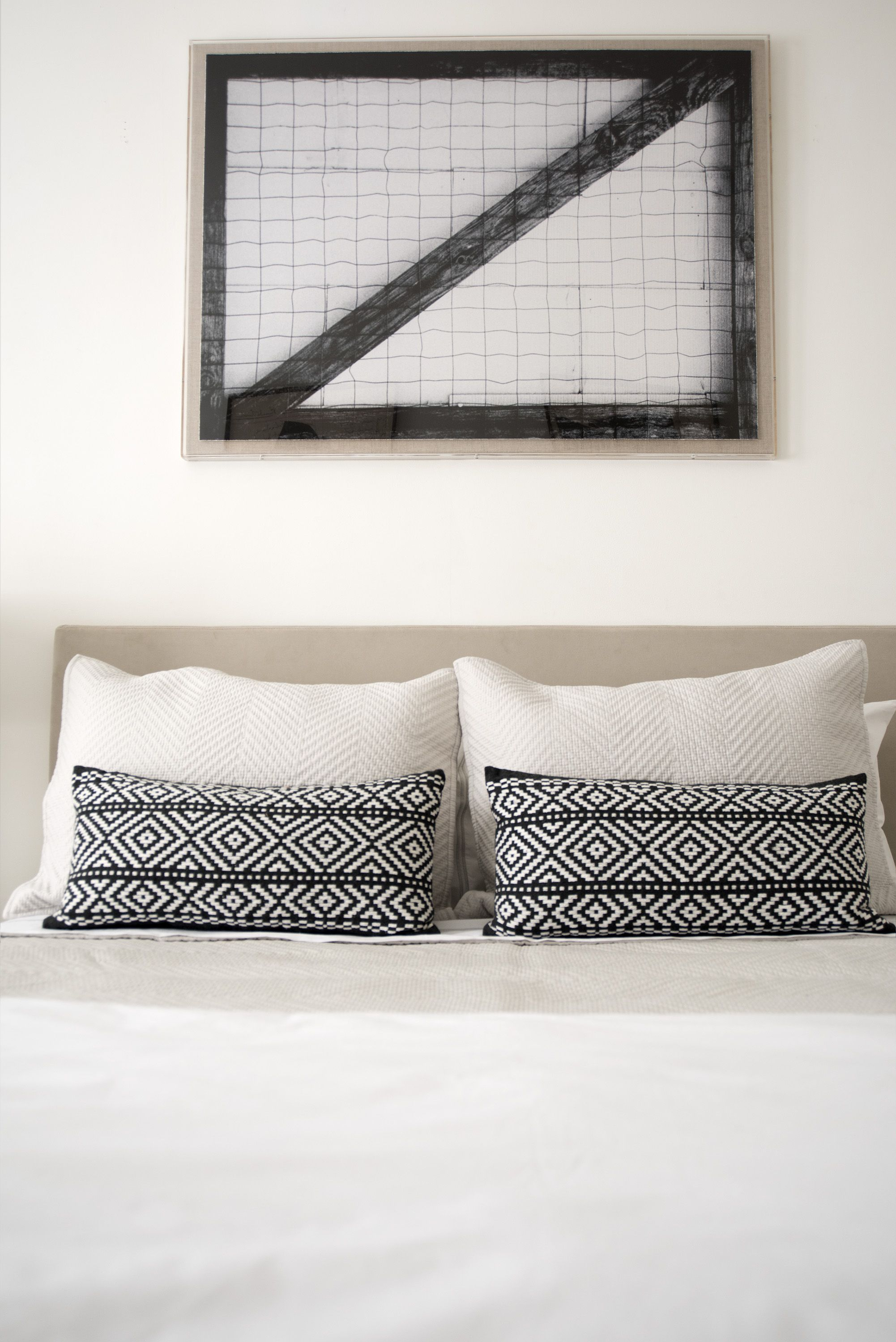 In The Modern Heritage Guest Bedroom, Bright White Walls Host
