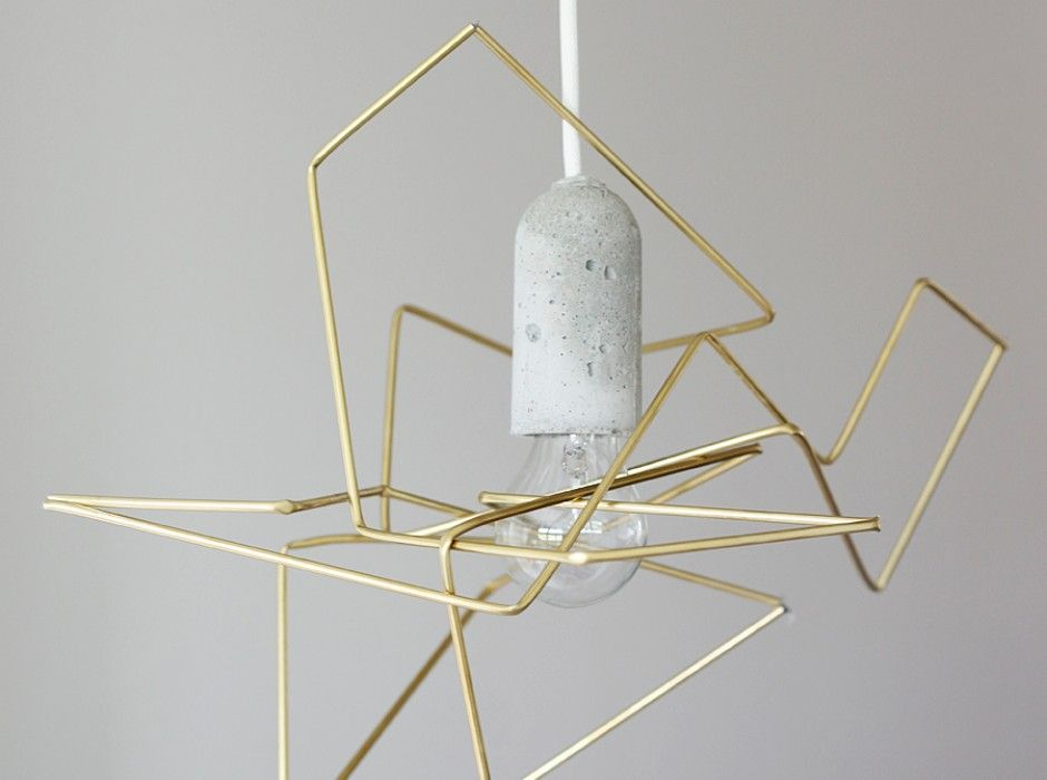 DIY Geometric Lampshade By Weekday Carnival - Riikka Kantinkoski, the Finnish creative behind Weekday Carnival, decided to create her own DIY project - golden pendant lamp using metal tubing from the hardware store and the fantastic-in-its-own-right Base lamp from Nud...