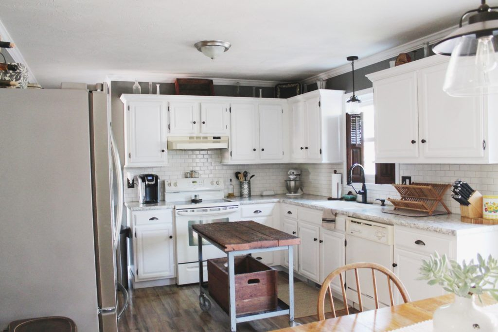 our kitchen before and after our farmhouse and rustic style kitchen renovation with diy white on kitchen cabinets painted before and after id=50264