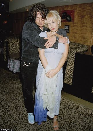 Michael Hutchence. With Paula Yates.