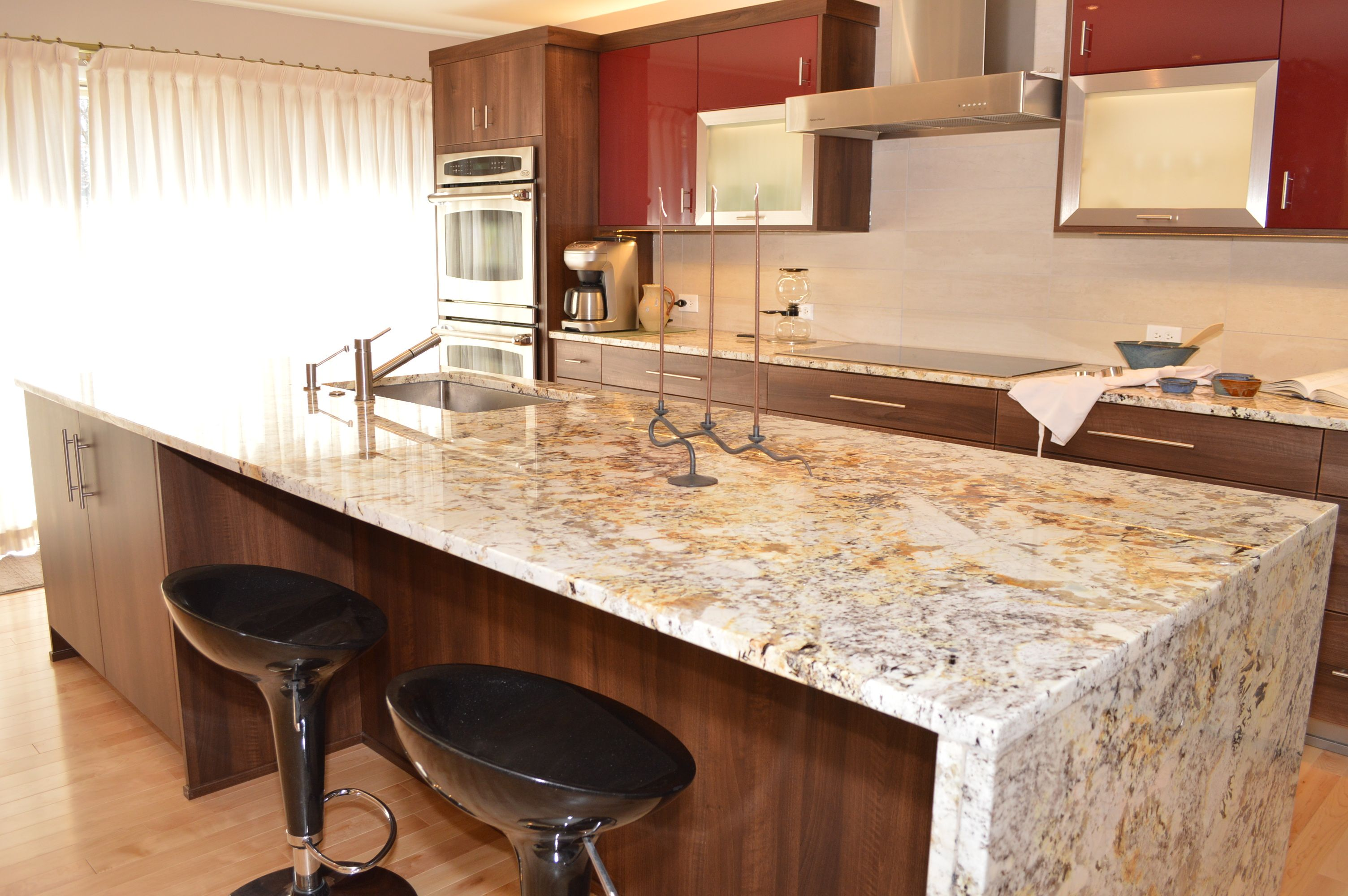 A waterfall edged granite island is fabricated for a for Stone kitchen island