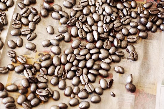 spray paint coffee beans silver and use as vase filler... put a handful of beans at a time in a paper lined bowl. spray the beans. shake up the bowl. repeat until beans are fully colored. to avoid brown showing, do 2 coats.