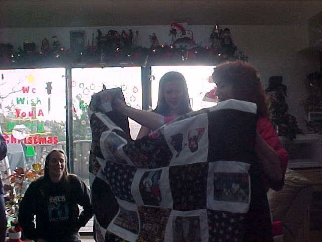 Your look of pride whenever you were around your daughter, Emily. This is the Christmas that she made me a memory quilt - little did I know at the time the extra meaning