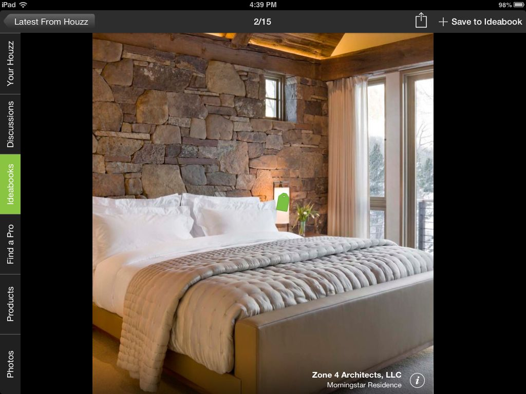 Love the ceiling uokiting the textured stone wall behind the bed