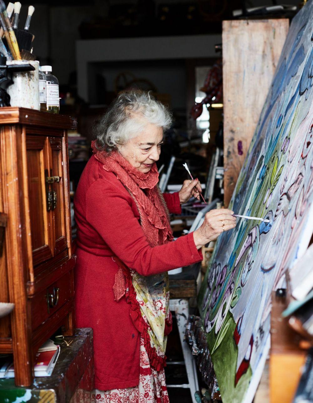 The Inimitable Mirka Mora in her studio painting - The Design Files | Australia's most popular design blog #MirkaMora #makers #workspace #paintings #artist