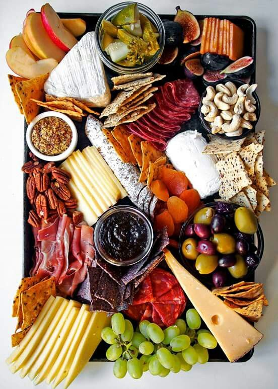 Nice assortments of meats, cheeses and accompaniments for a charcuterie tray...