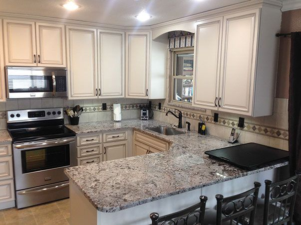 Beautiful remodeled kitchen with granite counter tops Contact us - remodeling estimate