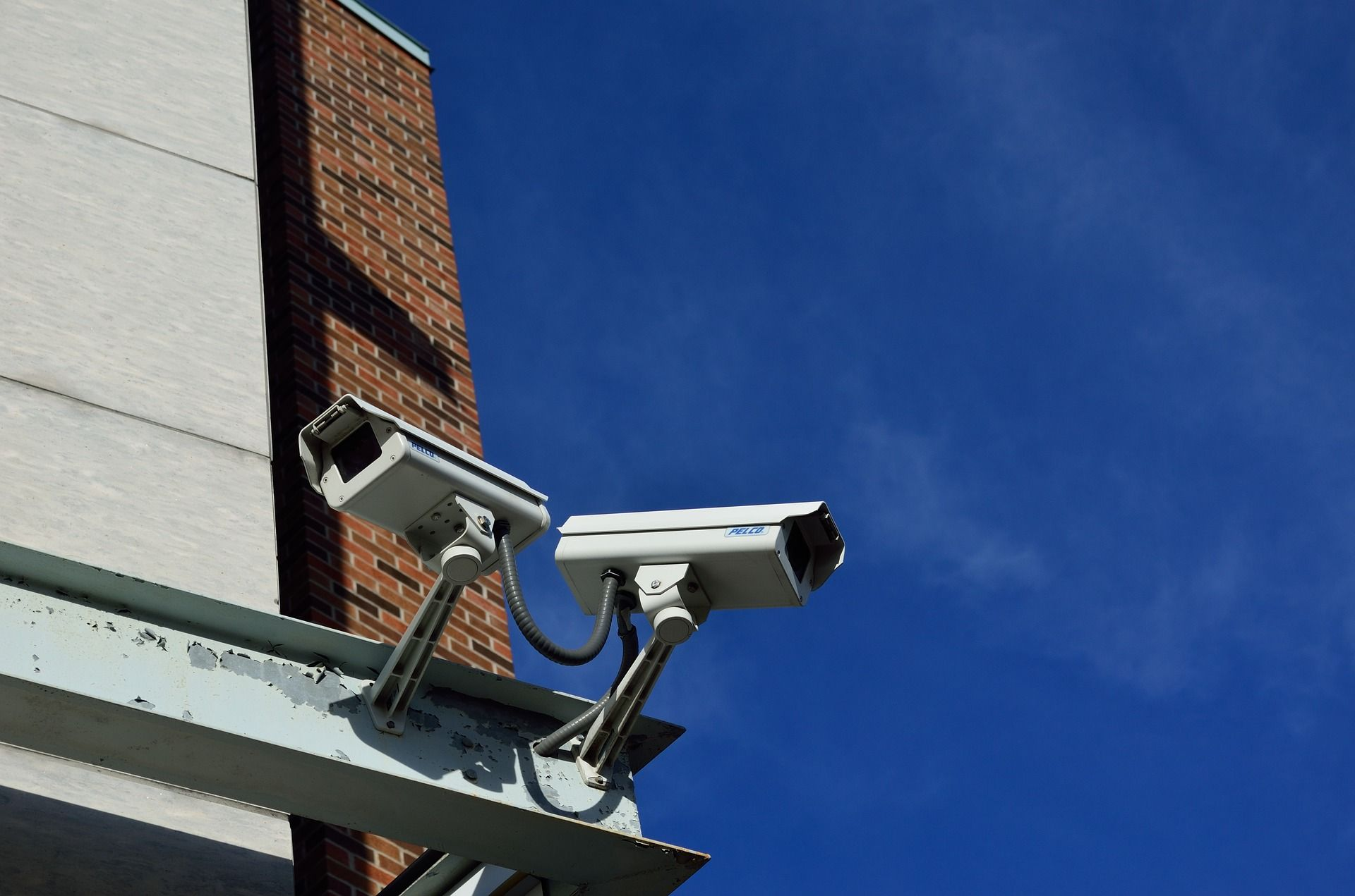 Two CCTV cameras on a building
