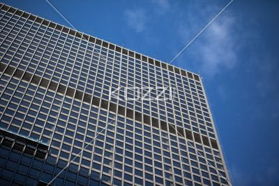 low angle view of office building. - Low angle shot of a tall office building against sky.