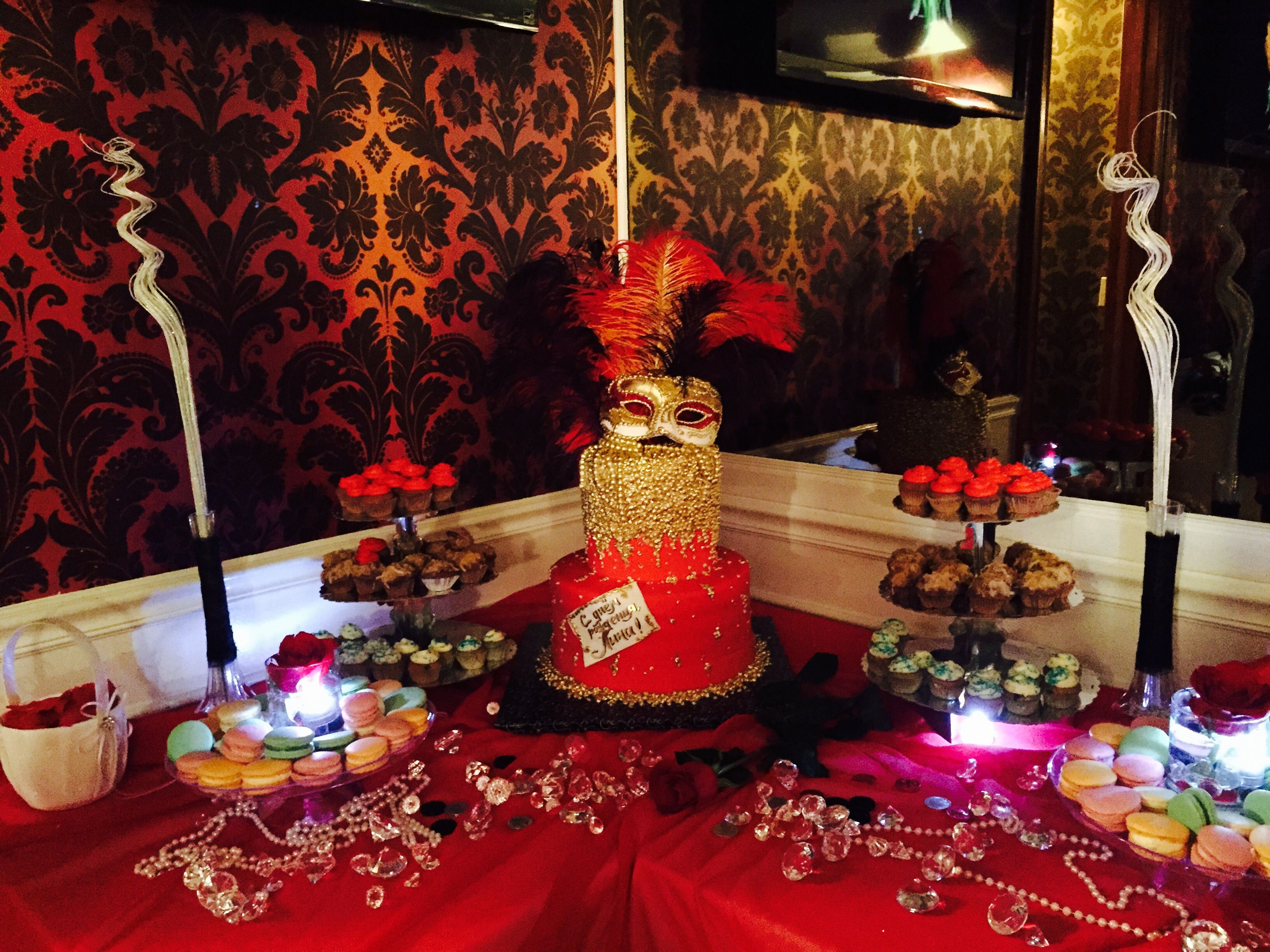 Sweet table at a masquerade themed red black gold party for Gold party