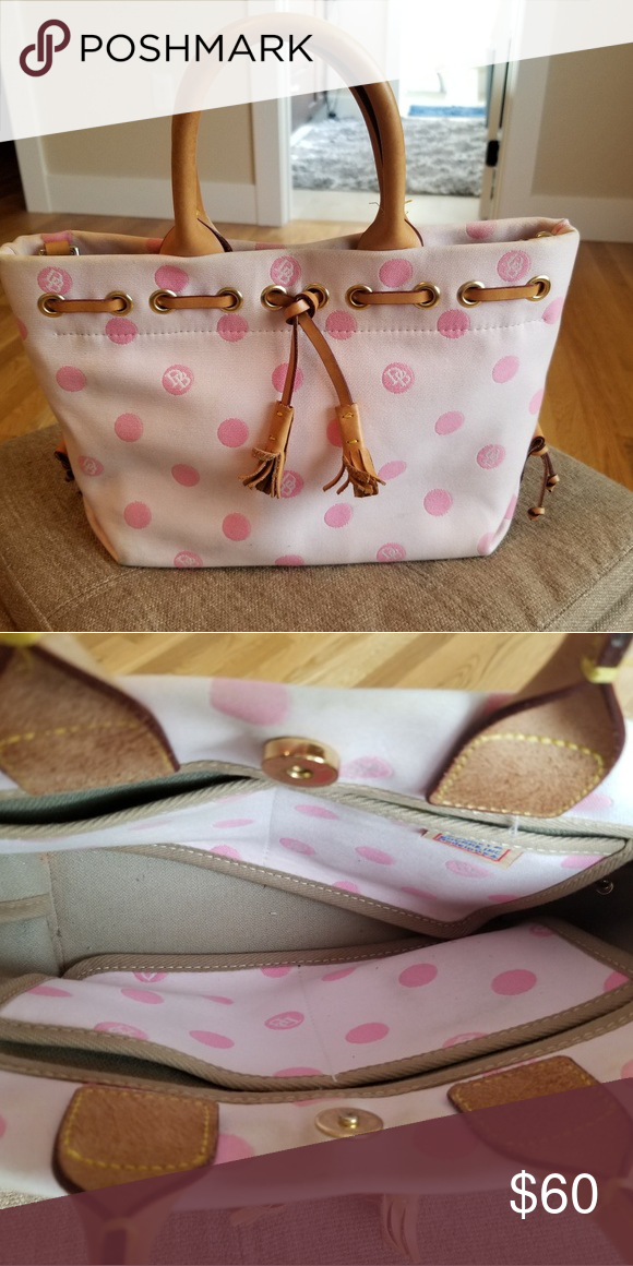 8b8dfba2cdf6 Dooney   Bourke tassle tote Light pink with darker pink polka dots...  Leather handles as well as a removable and adjustable shoulder strap.