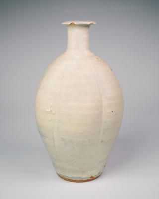 Bernard Leach, Large bottle with standing neck and everted rim, reduced stoneware, brushed white slip (hakeme) ...