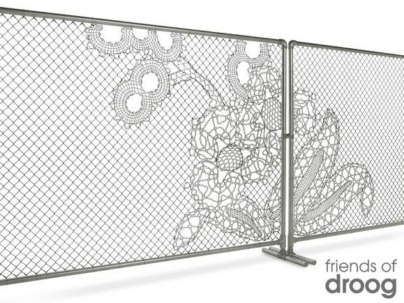 Lace fence by DROOG.  Introducing a patch of embroidered wire within industrial fencing, Dutch design house Demakersvan combine the small and sensitive with the powerful, large and industrial. Lace fence is a customizable high-end metal fabric for outdoor and indoor use, suitable for anything from fencing, staircase railings, room dividers, to balcony railings and building facades