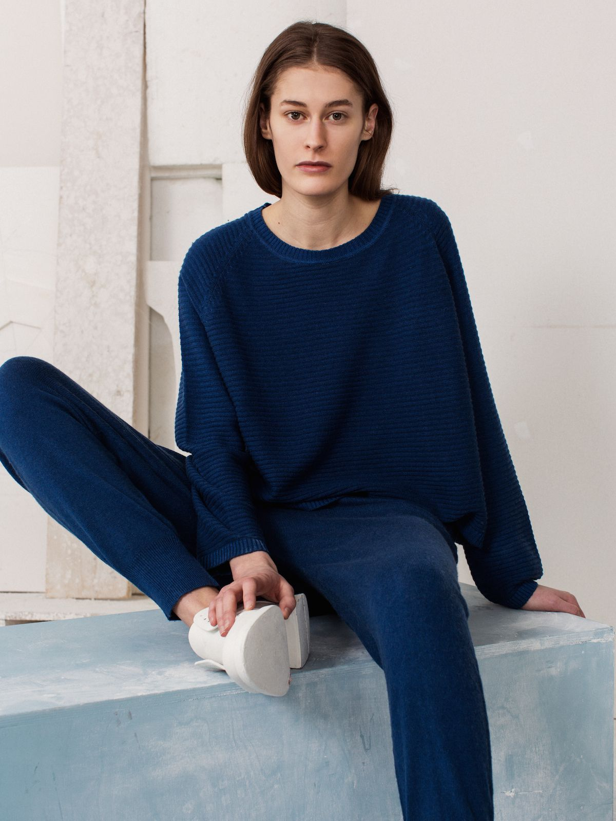"Arela A/W 15 Collection ""Lunar Mare"".    Noelle sweater and Kaoru sweatpants in cashmere.   Photography Osma Harvilahti, art direction Linda Bergroth, model Caroline Farneman."