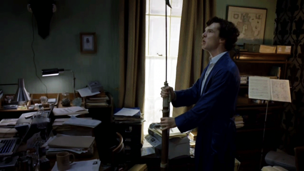 Benedict Cumberbatch as BBC Sherlock Holmes in his blue robe with a harpoon