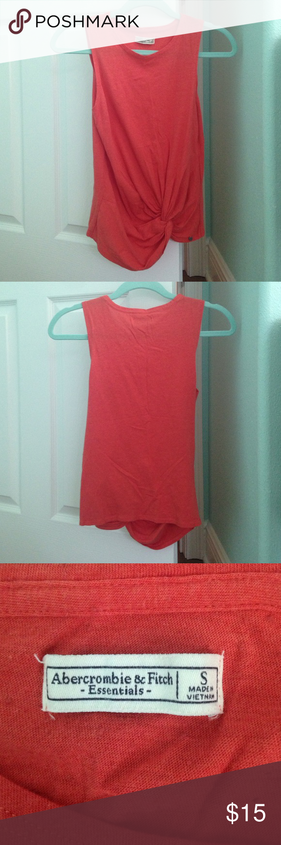 Casual top, is in great condition only worn once. The top is a orange/pink color, purchased from Abercrombie & Fitch. It is basically brand new (only been worn one time). It makes for a very cute outfit when paired with white or blue jeans. Abercrombie & Fitch Tops Tank Tops