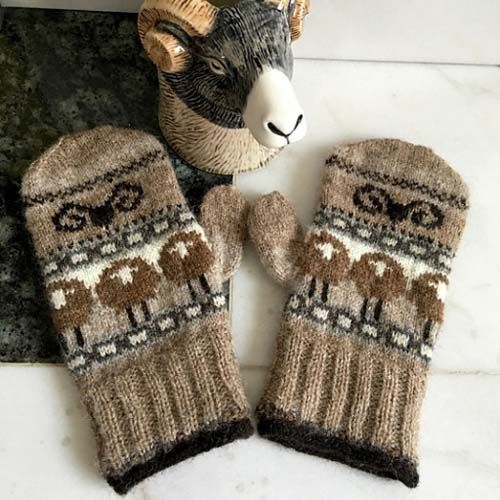 These lovely knitted mittens were created by modifying the original knit pattern to apply the sheep design. Talk about knitting mastery.