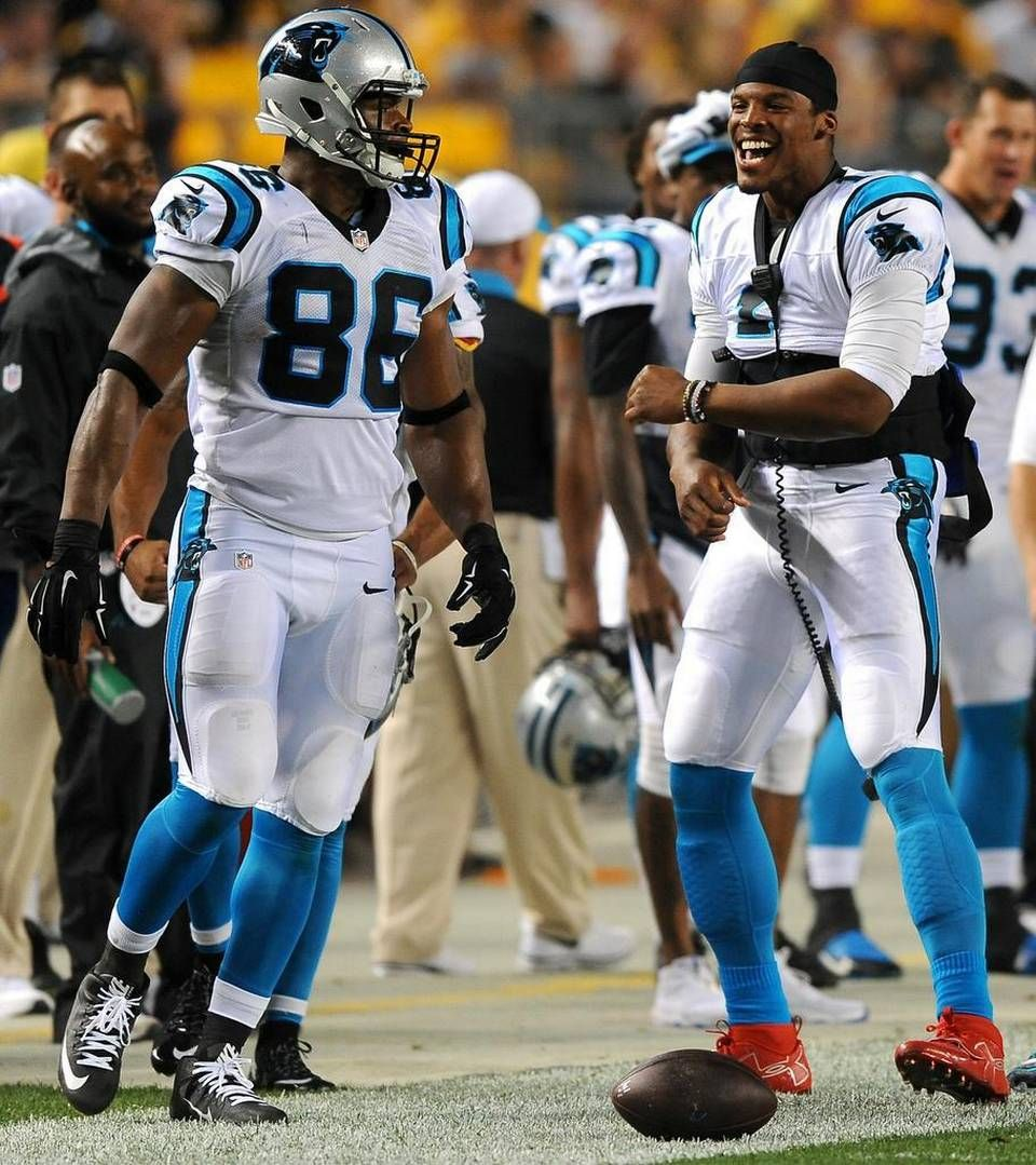 Carolina Panthers quarterback Cam Newton right celebrates tight