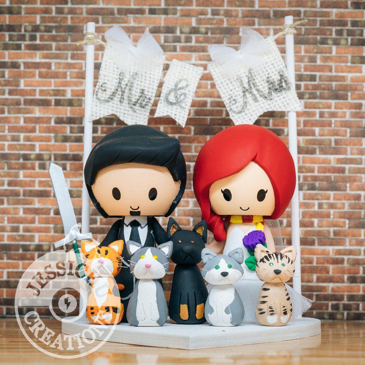 Groom holding long sword and irish bride wedding cake