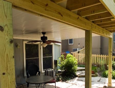 Pressure Treated Deck With Arbor And Powder Coated Aluminum Under Ceiling Guttering System Fan In Overland Park Ks