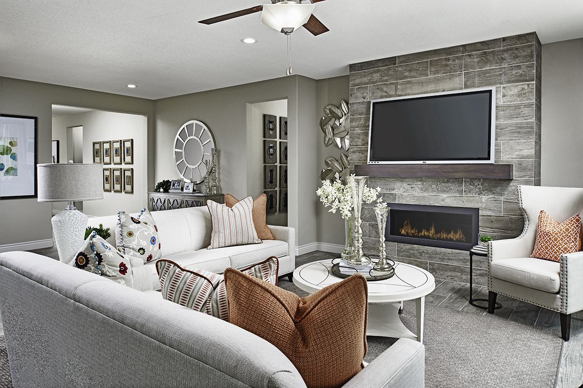 Warm Colored Throw Pillows Complement A Contemporary Fireplace
