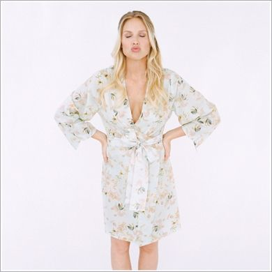 <p>Hand-painted watercolor blooms rest upon this dreamy kimono sleeve-style crossover robe with self-tie sash and inner tie. On whisper-soft cotton voile, this beauty is perfect for the sweet unwind or the bloom of getting ready.</p>