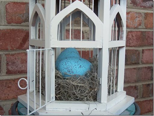 Colored eggs in a lantern cage.