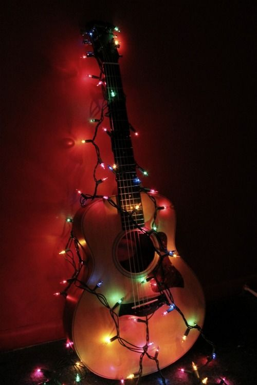 Rockin 39 around the christmas tree rock guitar rockin for Acoustic guitar decoration ideas