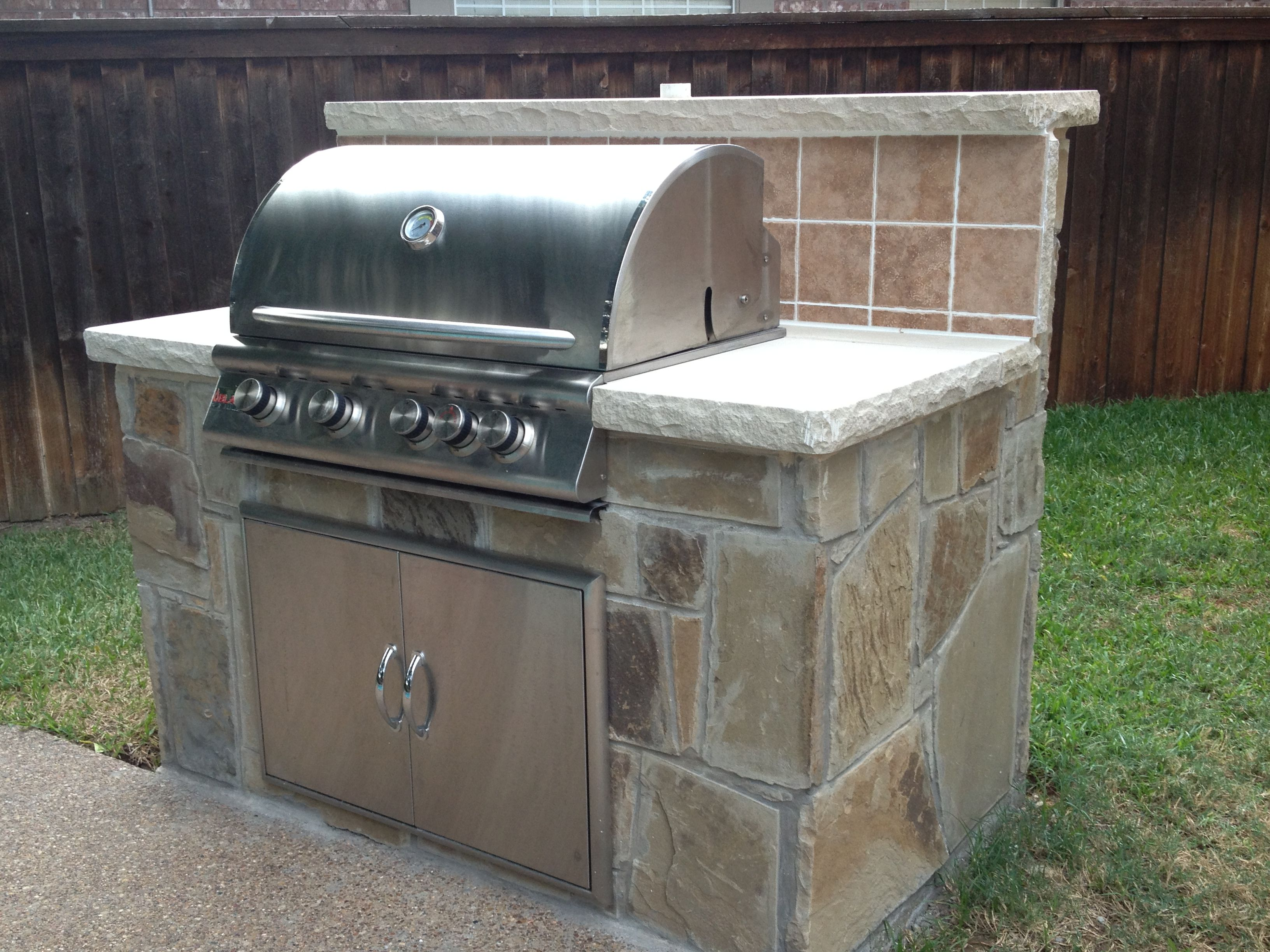 Our new bbq grill island with stone surround with inspiration from
