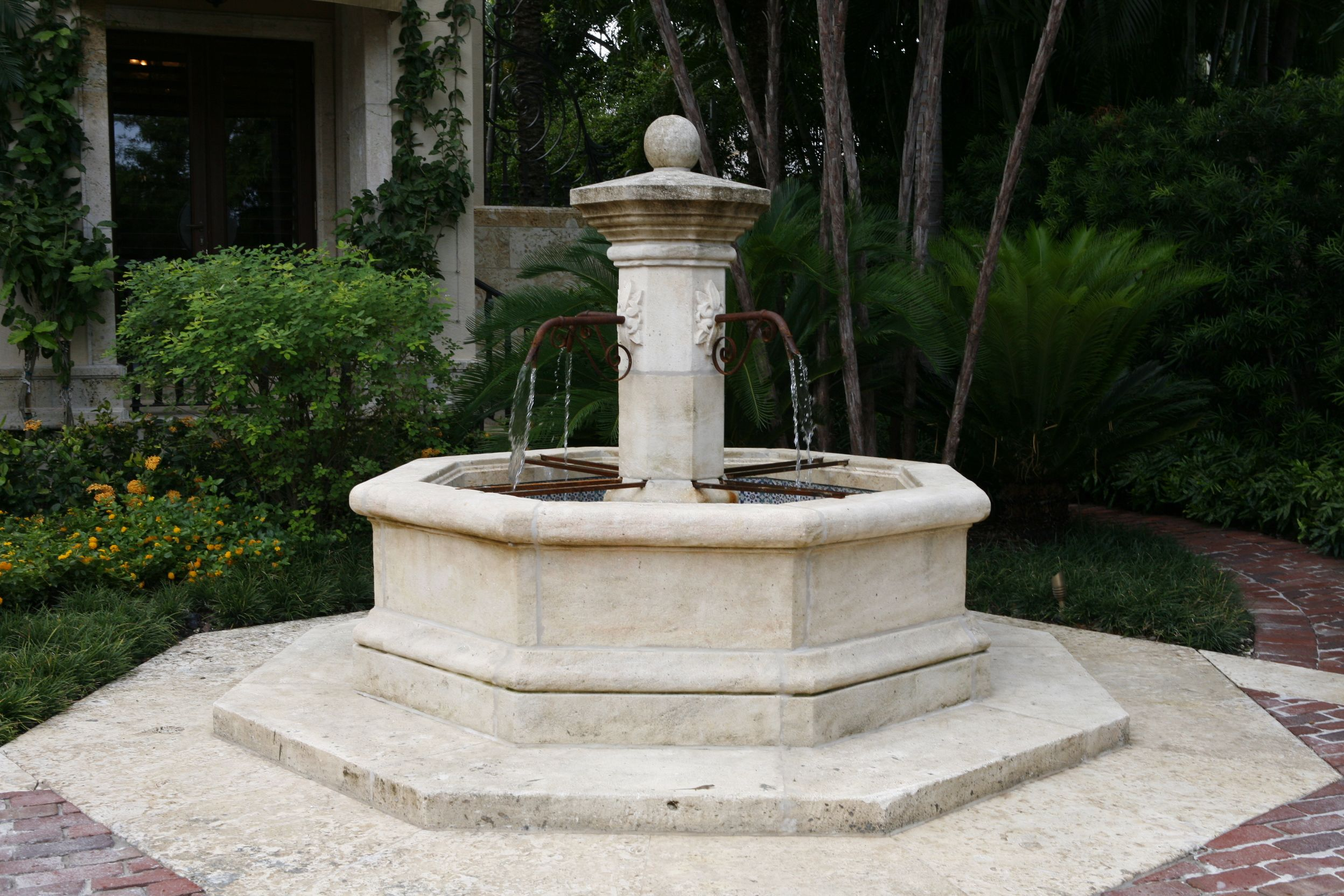 this stunning central water feature is hand carved french limestone  this fountain adds elegance