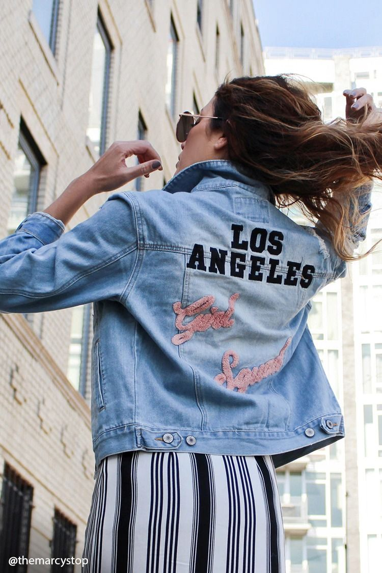 5ad929f7455d A distressed denim jacket featuring an embroidered
