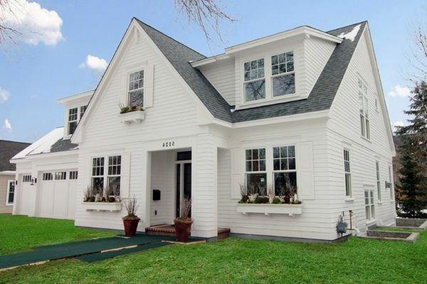 wei es haus auf zwei etagen graues dach und gr ne fl chen. Black Bedroom Furniture Sets. Home Design Ideas