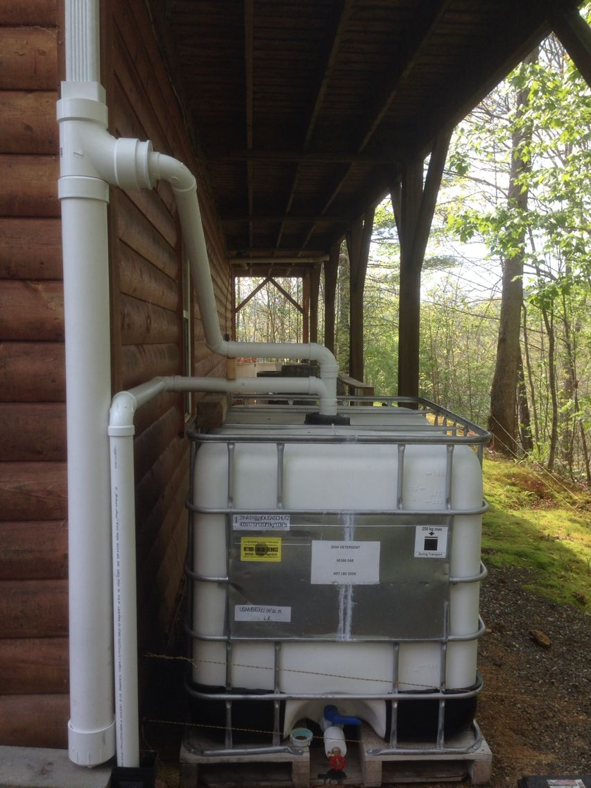 """Rain water catchment using an IBC Tote and common PVC pipe and fittings. 4"""" section is a homemade first flush diverter."""