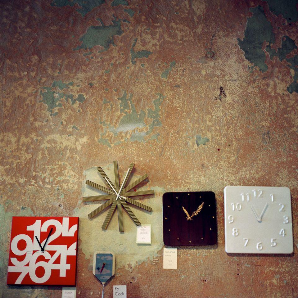 Various clocks & chipped walls