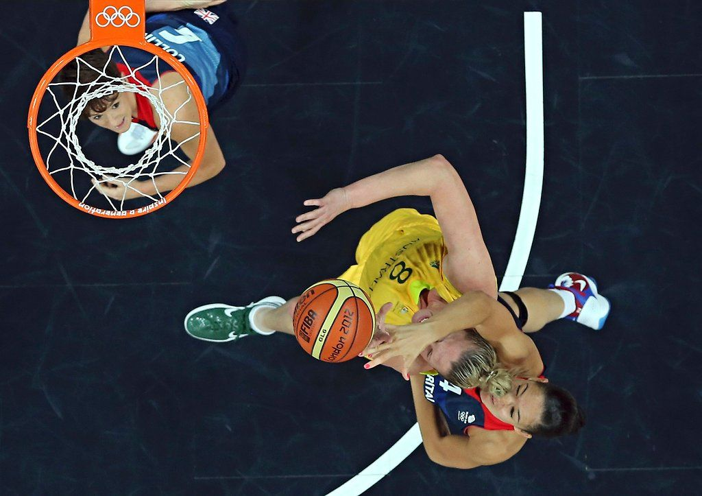 Great Britain's Azania Stewart, right, grabs Australia's Suzy Batkovic during a women's basketball match.