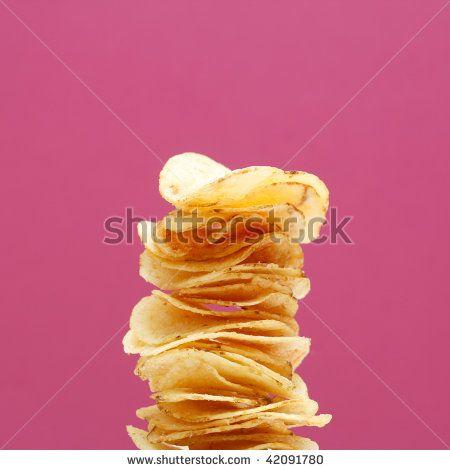 Stack of potato chips by Lasse Kristensen