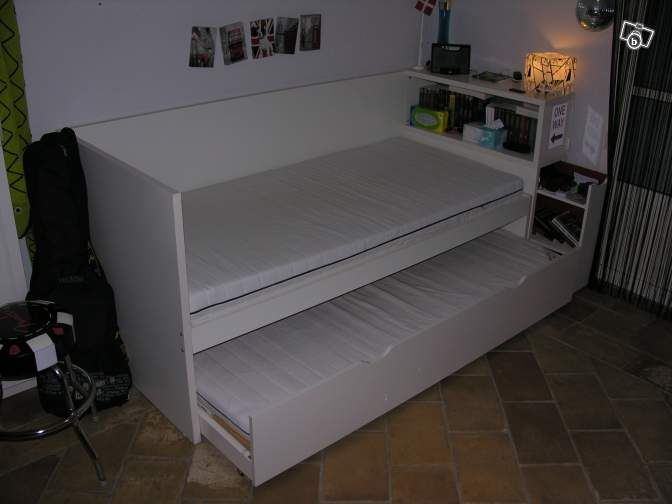 Ikea Flaxa   trundle bed with headboard that has bookshelves all