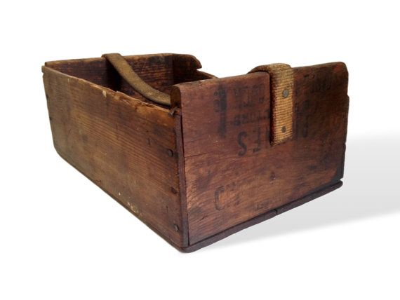 This primitive tool caddy is packed with character! It was made from an old fruit crate and has a thick canvas handle. The wood has a rich,
