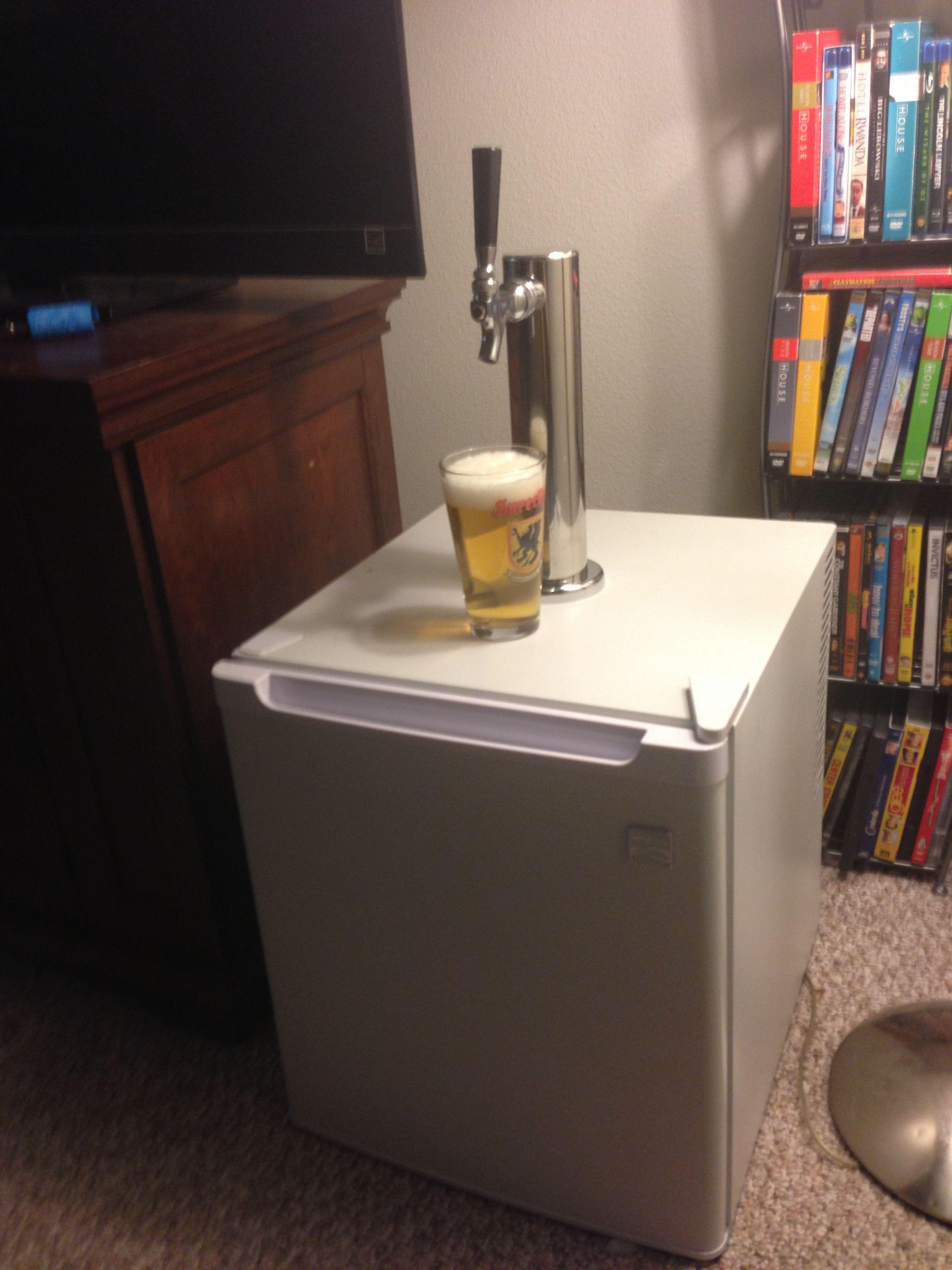 $75 Homemade mini kegerator built using $15 Kenmore (clearance) mini fridge and a $50 eBay beer faucet . Uses Heineken mini kegs.