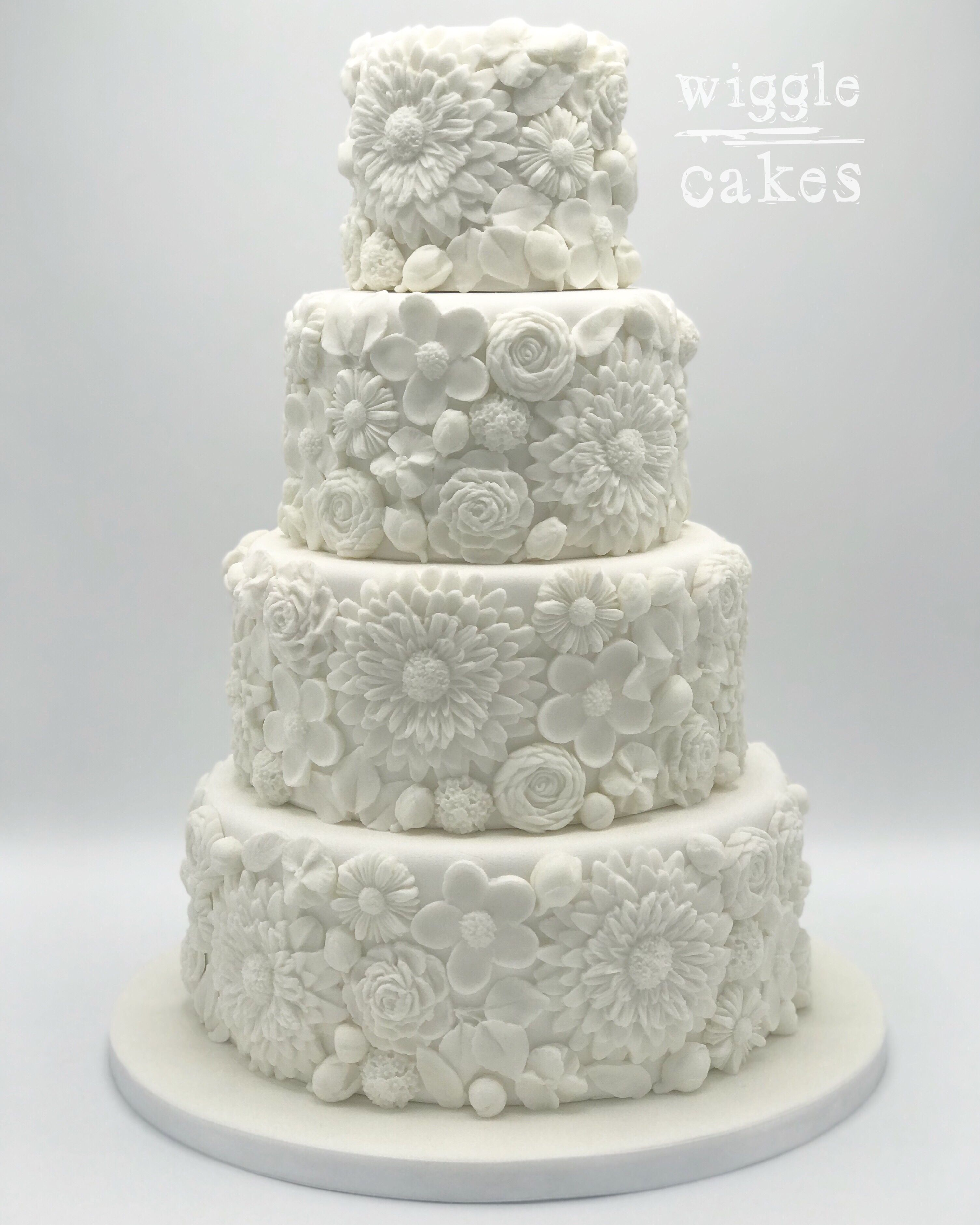 4 tier wedding cake covered in pretty edible white flowers | Wedding ...