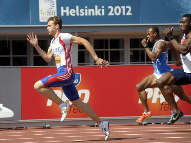 Day 1: French Christophe Lemaitre during men's 100 m sprint qualification at the European Athletics Championships Helsinki 2012 in Helsinki on Wednesday, 27th June, 2012. Right Great Britain's Harry Aikines-Aryeetey.