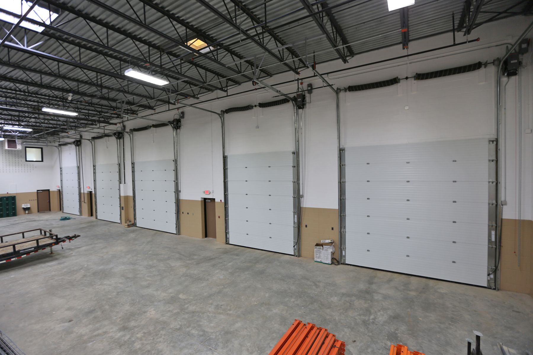 Commercial overhead garage door - Inside Karon Masonry S Warehouse Insulated Commercial Garage Doors High Lift Track Manufactured By
