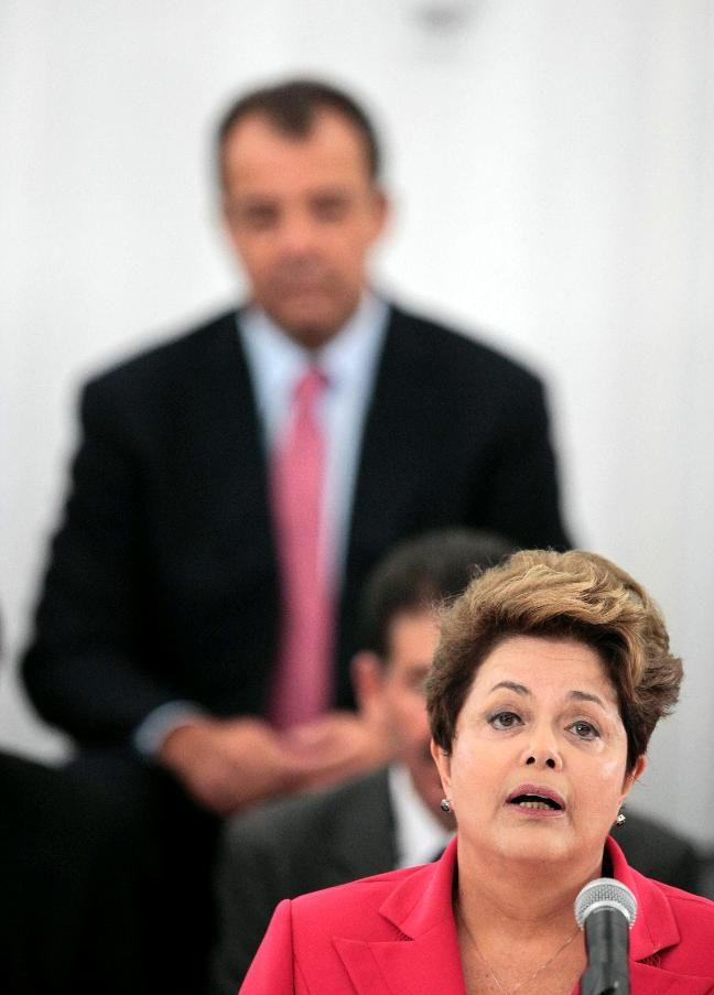 Brazil's President's Dilma Rousseff (front) speaks in front of Rio de Janeiro's governor Sergio Cabral during the opening of the Brazil Pavilion for the Rio+20 United Nations sustainable development summit in Rio de Janeiro June 13, 2012. Rio+20 summit will be held from 20 to 22 June. REUTERS/Sergio Moraes
