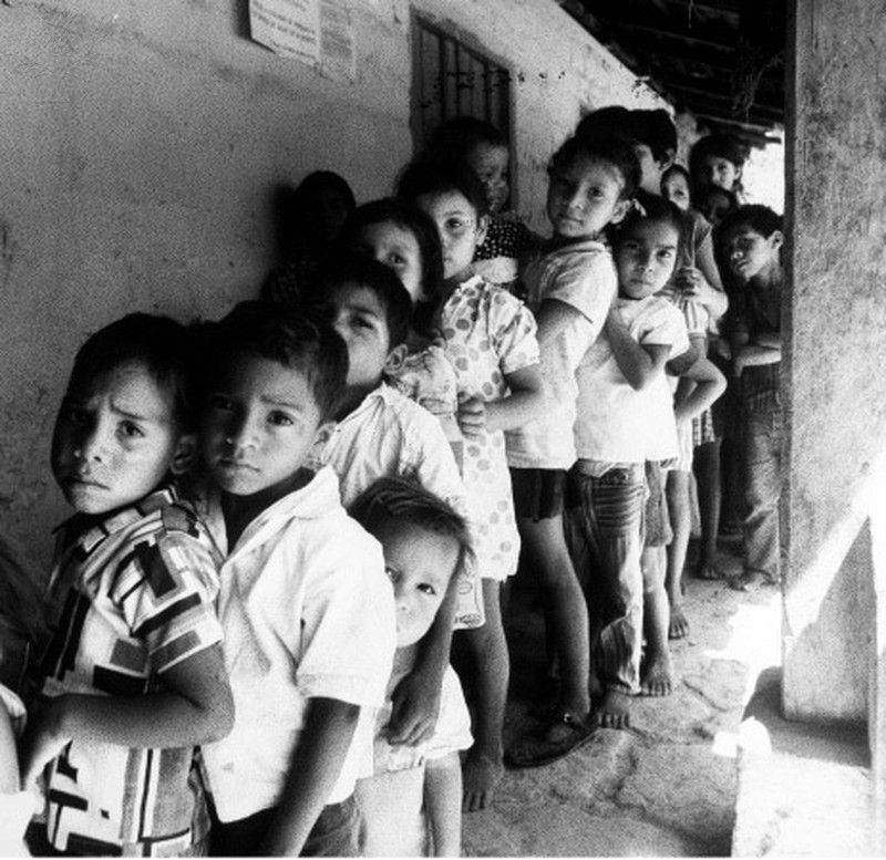 Children in La Venta, Honduras lining up to receive lunches provided by the United Nations World food program.