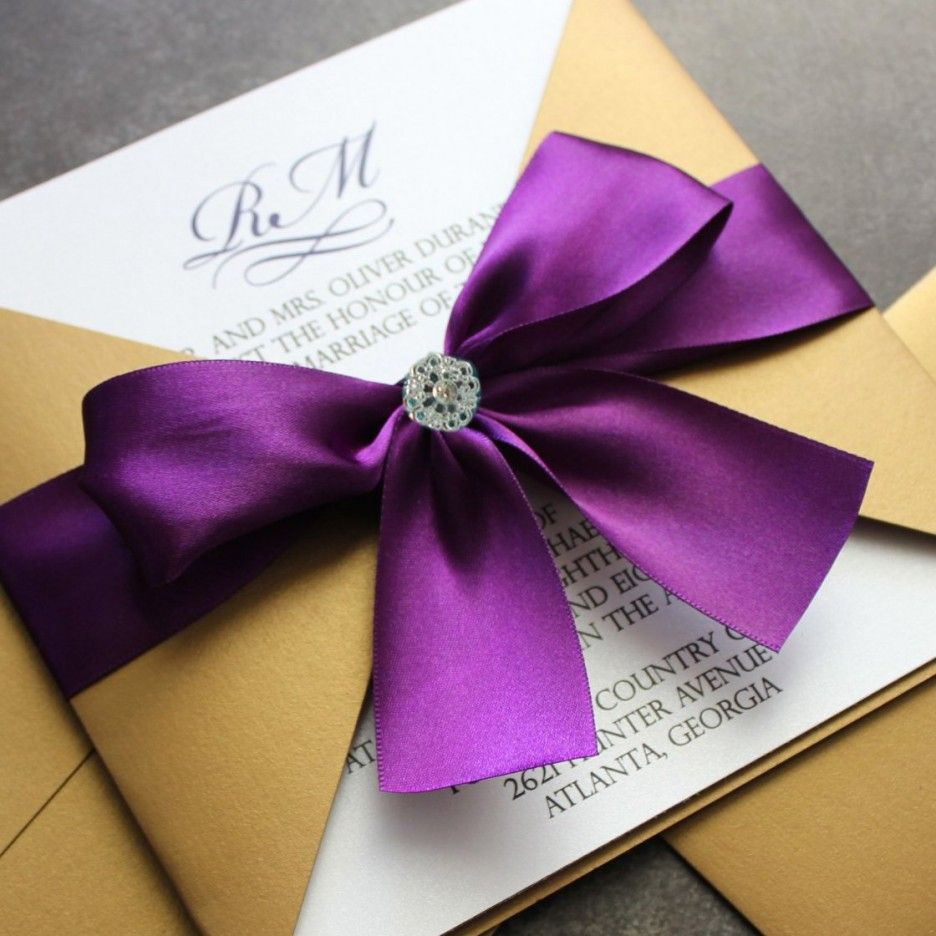 Invitations. Unique brown wrapping for white card with purple ribbon ...