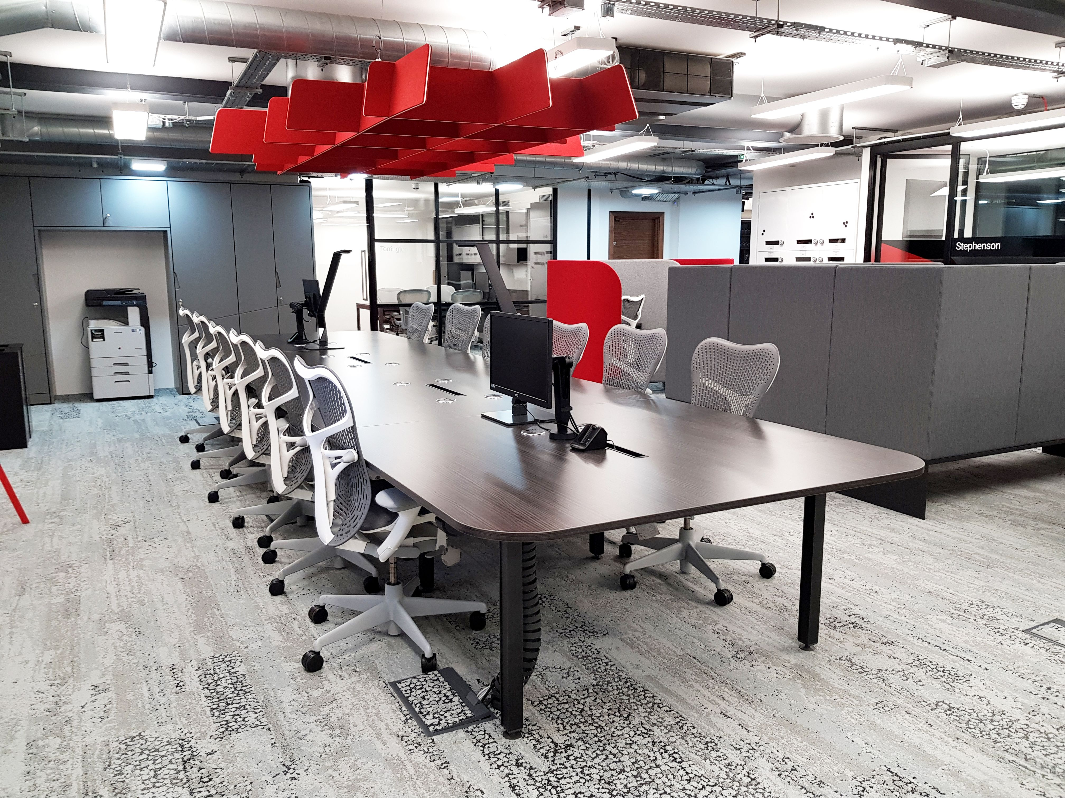 Tsunami Axis London Showroom Sense Team Table And Mirra 2 Task Chairs By Herman Miller Ollin Monitor Arms By Workplace Design Commercial Furniture Team Table